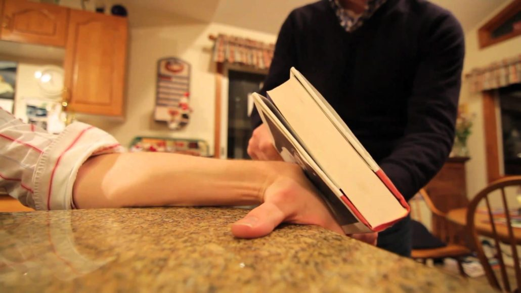 Smashing a ganglion cyst with a book